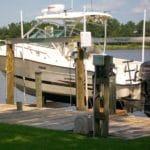 White boat sits on IMM Quality AlumaHoist boat lift
