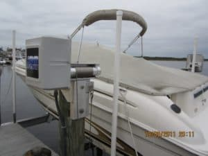 Side view of white boat sitting on IMM Quality Platinum Series beamless boat lift
