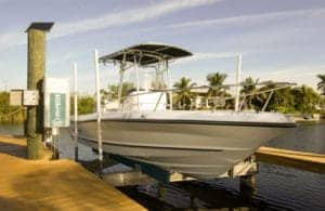 White boat sits on IMM Quality boat lift with dock installation