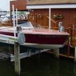 Red boat sits on IMM Quality Alumavator boat lift
