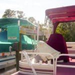 Two side by side boats sit on IMM Quality Alumahoist boat lifts