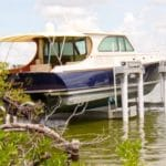 Small image of navy boat named Mary D safely stored on an IMM Quality Boat Lift