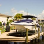 Large white boat with custom dock installation and IMM Quality boat lift