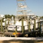 Yacht named Burning Daylight stored above the water on IMM Quality boat lift with custom dock installation