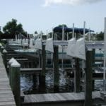 Marina with 9 boat slips and 3 boats that use IMM Quality Boat Lifts for safe secure storage