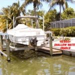 White boat stored on IMM Quality boat lift with shallow water cradle rated for 10000 pounds