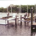 Two empty IMM Quality boat lifts at marina