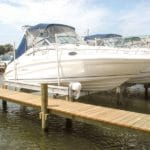 White yacht with navy cover sits on IMM Quality boat lift Titan yacht lift