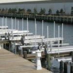 Long row of IMM Quality Alumavator Boat Lifts at a multi-slip marina