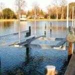 IMM Quality Alumavator boat lift sits along a northern lake ready for use