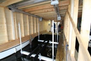Boathouse Lifts Gallery - image Alumator-Hi-Speed-in-Boathouse-300x200 on http://iqboatlifts.com