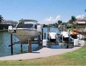 Boat dock with a boat and 2 jet skis
